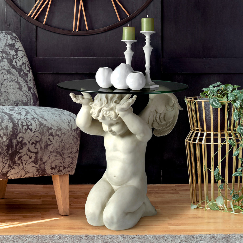 cherub on knees holding a round glass table top overhead