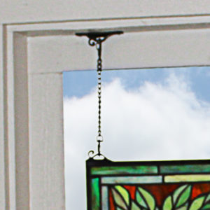 Included scroll brackets and chains for hanging